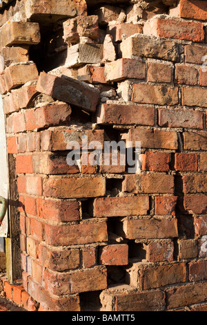 dilapidated brick wall of old building - Stock Photo