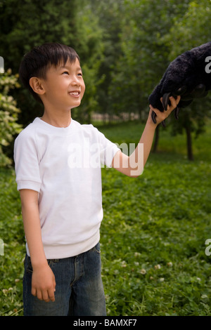 Young Boy Holding An Animal Paw - Stock Photo