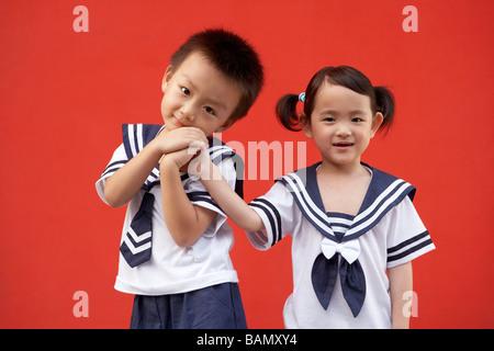 Children in their school uniforms - Stock Photo