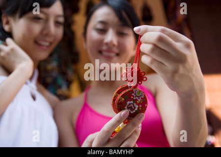 Two young friends shop for souvenirs - Stock Photo