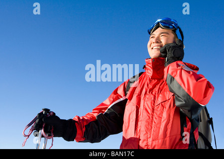 Young man in ski gear talking on his mobile phone - Stock Photo
