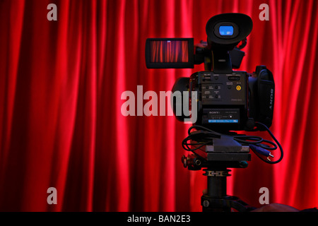 Full HD camera recording a red curtain - Stock Photo