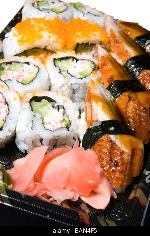 japanese food eel sushi sashimi california rolls lunch box with ginger - Stock Photo