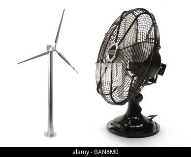 A model wine turbine and a metal desk fan - Stock Photo