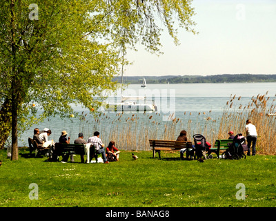 People Enjoying the Fraueninsel Chiemsee Chiemgau Bavaria Germany - Stock Photo