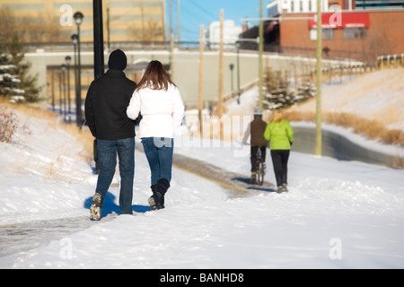 Edmonton, Alberta, Canada; Two couples walking on a path - Stock Photo