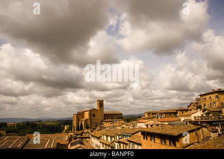 Wide-angle rooftop view of Ancient walled city of Siena Italy and San Domenico cathedral also known as Basilica Cateriniana
