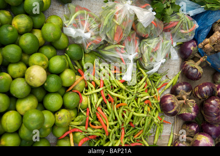 Fresh chillies and limes on sale in Luang Prabang market Laos - Stock Photo