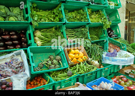 Vegetables outside a greengrocers in a Valletta side street, Malta. - Stock Photo