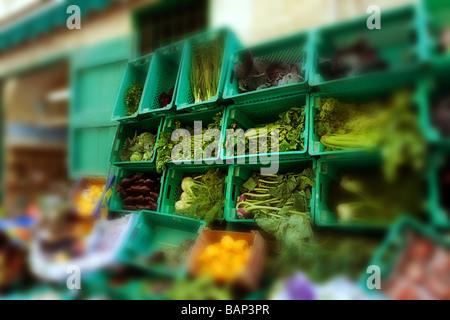 Vegetable shop in Valletta, Malta with blurred background. - Stock Photo