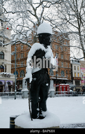 Snow-covered statue of Charlie Chaplin in Leicester Square, London, UK - Stock Photo