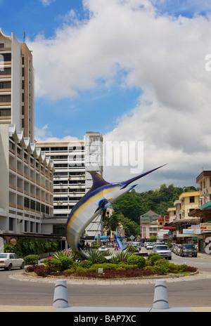 City street and fish sculpture Kota Kinabalu Sabah Borneo - Stock Photo