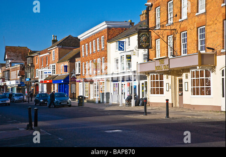 Shops and pub in the High Street in the typical English market town of Marlborough Wiltshire England UK - Stock Photo