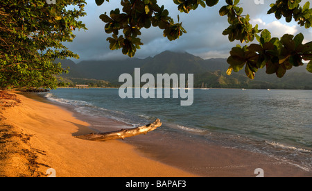 Scenic Kauai Hawaii Sunset from North Shore Princeville beach to Bali Hai including Hanalei Bay boats and pier in - Stock Photo