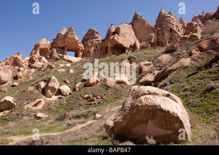 Ancient cave dwellings in Cappadocia Turkey - Stock Photo