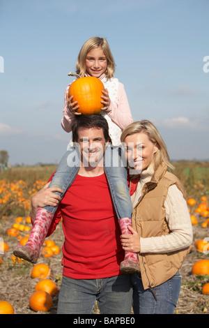 Couple in organic pumpkin patch, Ladner, British Columbia, Canada - Stock Photo