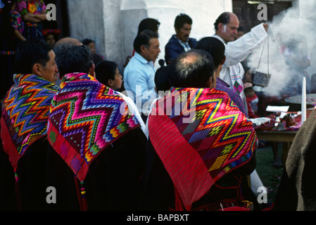 GUATEMALAN MEN of MAYA descent wrapped in traditional cloth at Christian service CHICHICASTENANGO GAUTEMALA - Stock Photo