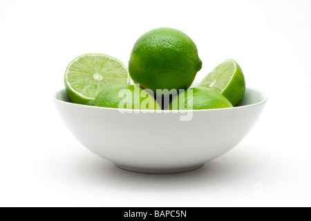 Bowl of limes - Stock Photo