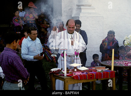 CATHOLIC PRIEST giving CHRISTIAN SERVICE on CHURCH STEPS CHICHICASTENANGO GUATEMALA - Stock Photo