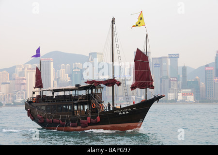 Tourist Chinese Junk Aqua Luna in Kong Kong Harbour - Stock Photo
