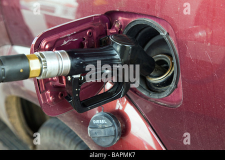 Filling tank of vehicle with fuel - Stock Photo