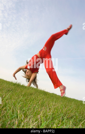 Six year old girl doing cartwheel, Winnipeg, Manitoba, Canada - Stock Photo