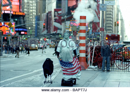 Performer dressed up as The Staue of Liberty who pose for photographs with Tourists in Times Square,New York,USA - Stock Photo