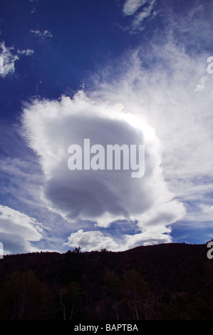 Dramatic sky and clouds over Colorado mountains - Stock Photo