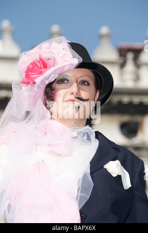 Venetian mask and creative fancy dress at the Carnival in Venice Italy - Stock Photo