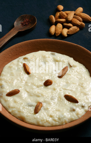 Shrikhand is a traditional Indian dessert made with thickened, strained yogurt and sweetened with sugar - Stock Photo