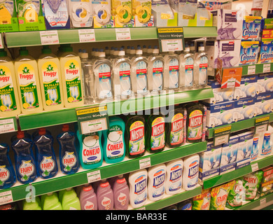 Dish washing and dish washing machine liquids on supermarket shelves in a SuperCor outlet of El Corte Ingles Spain - Stock Photo