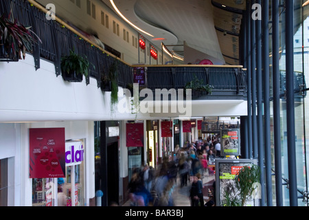Crowds of shoppers rushing about looking for last minute bargains inside the Overgate shopping mall in Dundee,UK - Stock Photo