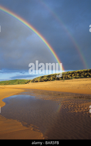 Double rainbow over Embleton Bay - Stock Photo