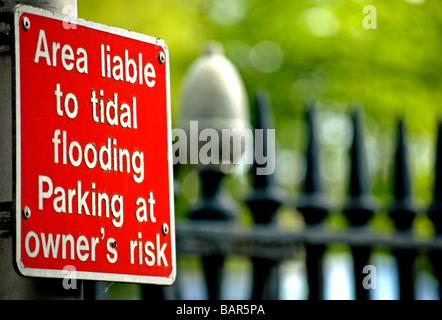 warning sign stating this area is liable to sudden flooding and that parked vehicles are liable to be submerged - Stock Photo