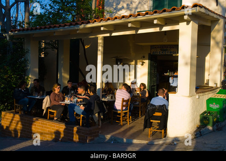Bar and cafe terrace in Plaka district of Athens Greece Europe - Stock Photo