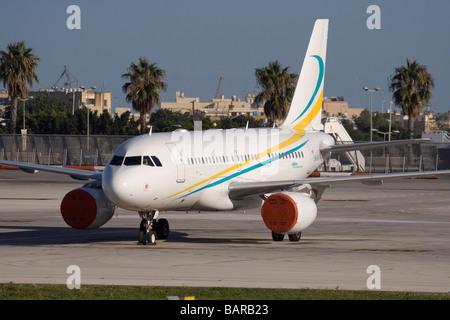 Comlux Aviation Airbus A319CJ corporate jet at Malta International Airport - Stock Photo