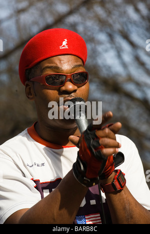 Black man who was doing break dancing in Central Park New York USA - Stock Photo