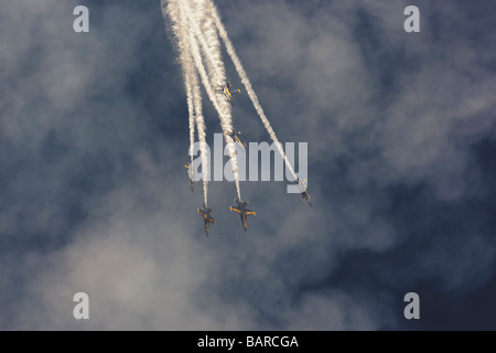 The Blue Angels Navy Flight Demonstration Squadron perform a high speed break maneuver at Seattle Seafair. - Stock Photo