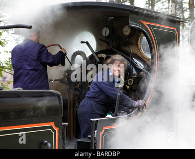 The volunteer lady 'fireman' of a L&Y railway steam locomotive seen at Weybourne station on the North Norfolk Railway - Stock Photo