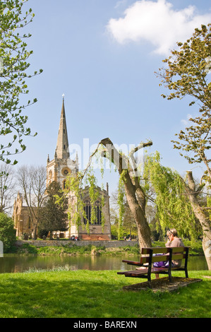 Vertical wide angle of Holy Trinity Church, where William Shakespeare is buried, on a bright sunny day - Stock Photo