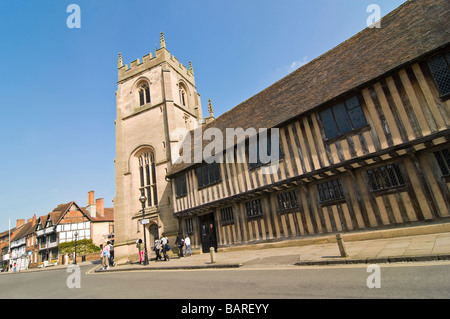 Horizontal wide angle of the old Tudor Almshouses Guild Chapel and Nash's House on Church Street on a bright sunny - Stock Photo