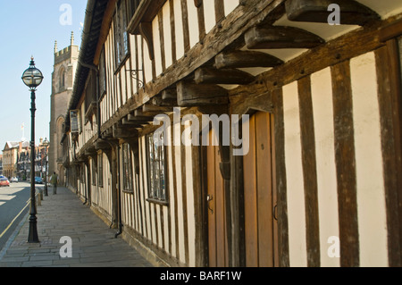 Horizontal wide angle of the old Tudor Almshouses and Guild Chapel on Church Street on a bright sunny day - Stock Photo