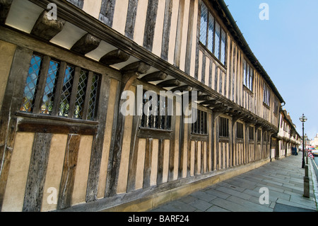 Horizontal wide angle of the old Tudor Almshouses on Church Street in Stratford-Upon-Avon on a bright sunny day - Stock Photo