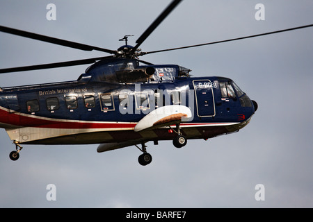 Sikorsky S61 helicopter taking off for the Isles of Scilly - Stock Photo