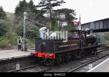 A Lancashire and Yorkshire railway steam locomotive seen taking water at Weybourne on the North Norfolk Railway, - Stock Photo