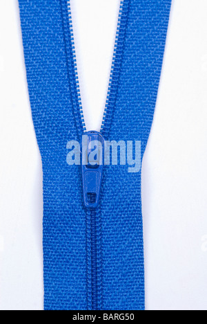 Close up of a blue zipper against a white background - Stock Photo
