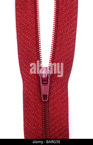 Close up of a red zipper against a white background - Stock Photo