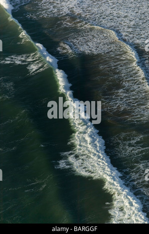 aerial view above Pacific ocean surface wave surf - Stock Photo