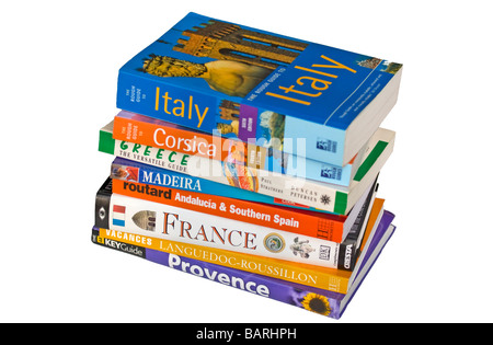 Cut Out of Stacked Travel Guide Books - Stock Photo