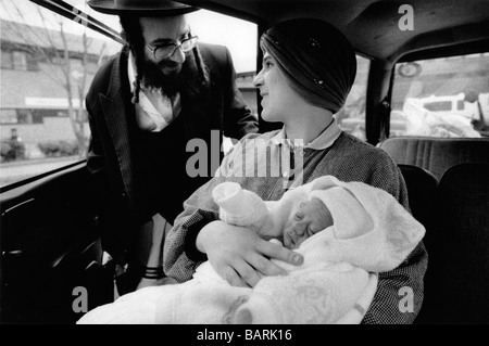 An Hassidic Jewish couple take home their first baby after delivery at the Homerton Hospital in Hackney , London - Stock Photo